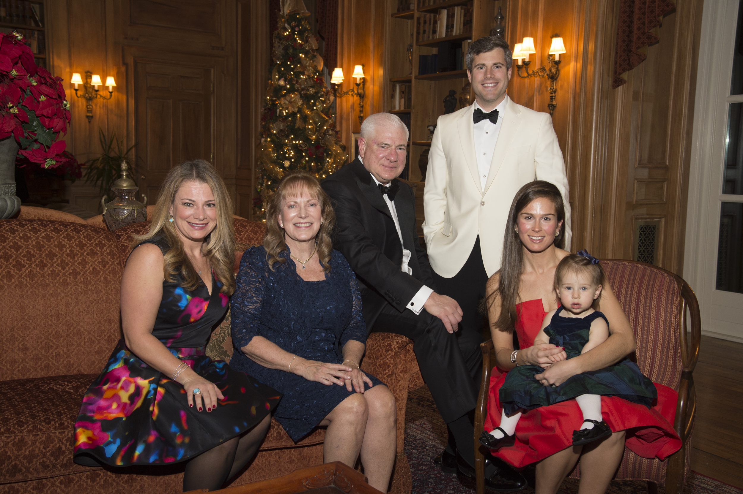 Honoree's Ted Weiss (seated) and Craig Weiss (standing) and their family.