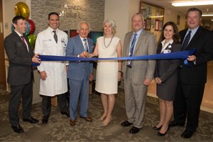 At recent ribbon cutting, from left to right: Dr. Adam Auerbach, Dr. Paul Wright, Mr. and Mrs. Manuel H. and Claire Barron, Dr. Alessandro Bellucci, Tara Laumenede, Ken McMillan