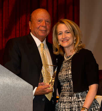 Saul Katz presents the Every Woman Matters Award to Stacey Rosen, MD.