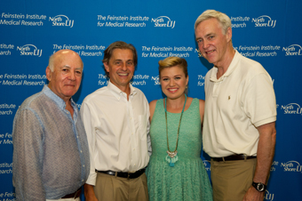 From left Leonard Feinstein, Kevin J. Tracey, MD, president of the Feinstein Institute; Kelly Clarkson, multi-platinum singer and songwriter; and Richard D. Goldstein, chairman, North Shore-LIJ Board of Trustees.